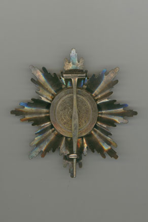 Grand Cross Star with swords on the ring by Scharffenberg